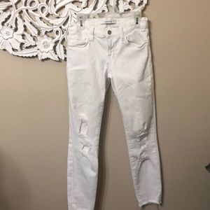 J BRAND 24 white ripped skinny jeans.